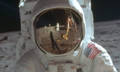Photo of astronaut Neil Armstrong reflected in the helmet of Buzz Aldrin