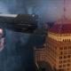 Composite photo of a handgun and downtown Fresno
