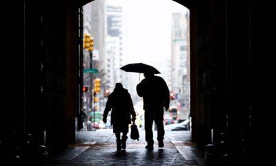 Photo of pedestrians passing beneath City Hall in Philadelphia