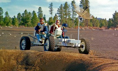 Photo of Apollo 15 astronauts, Jim Irwin and Dave Scott, driving a prototype of a lunar rover
