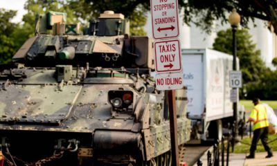 Photo of 1 of 2 Bradley Fighting Vehicles parked near the Lincoln Memorial
