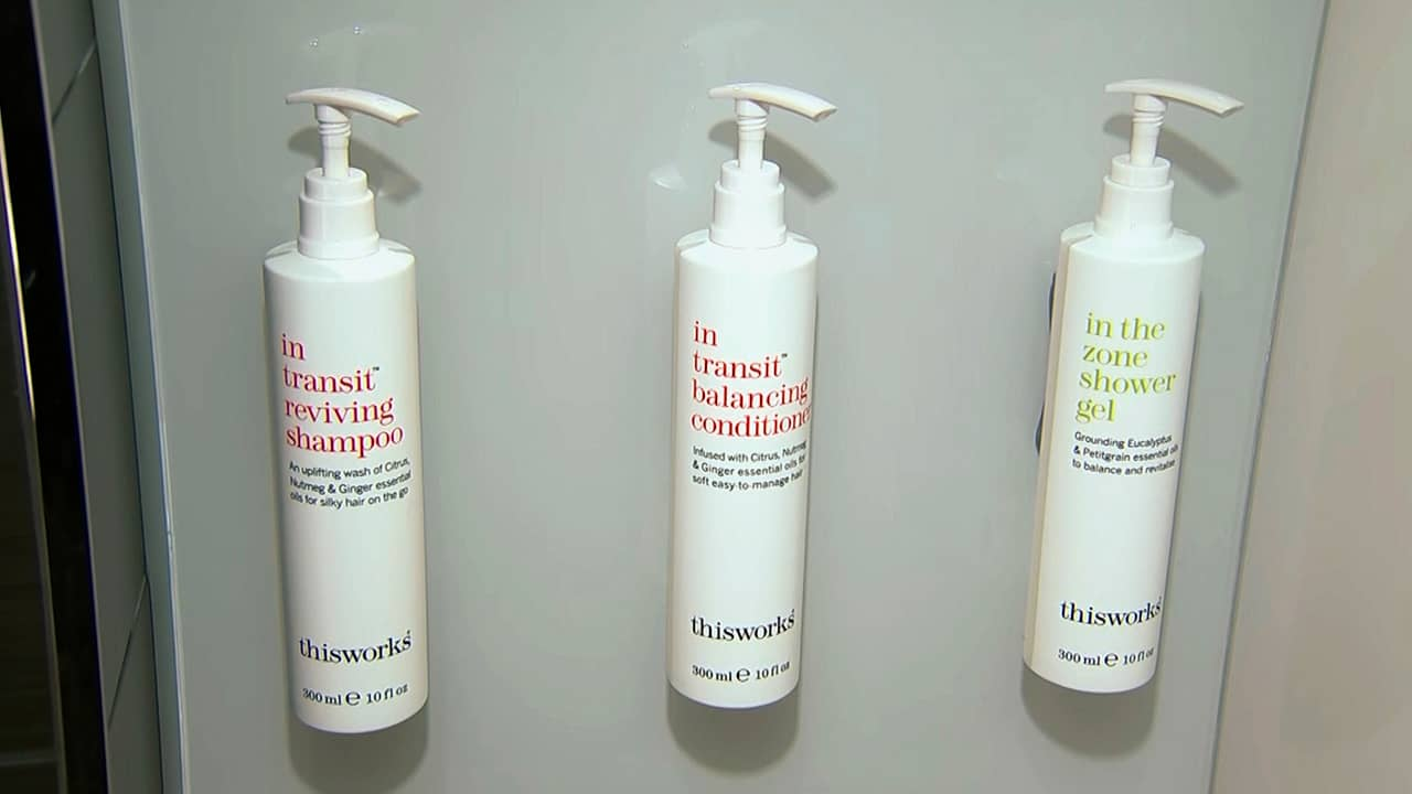 Photo of little shampoo, conditioner and shower gel bottles