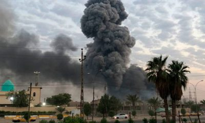 Photo of plumes of smoke rising at a military base in Baghdad, Iraq