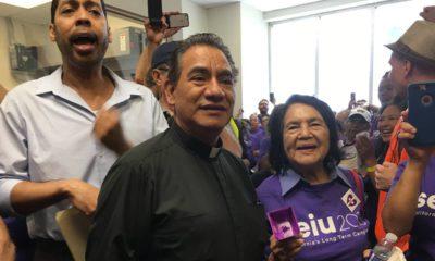 Photo Derek Smith and Dolores Huerta protesting