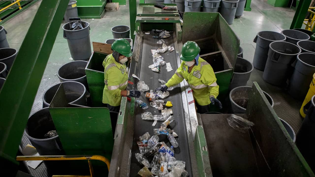 Photo of workers sorting through plastic items
