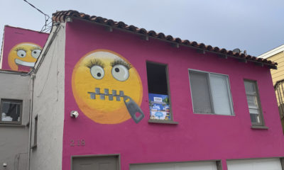 Pink house with emoji