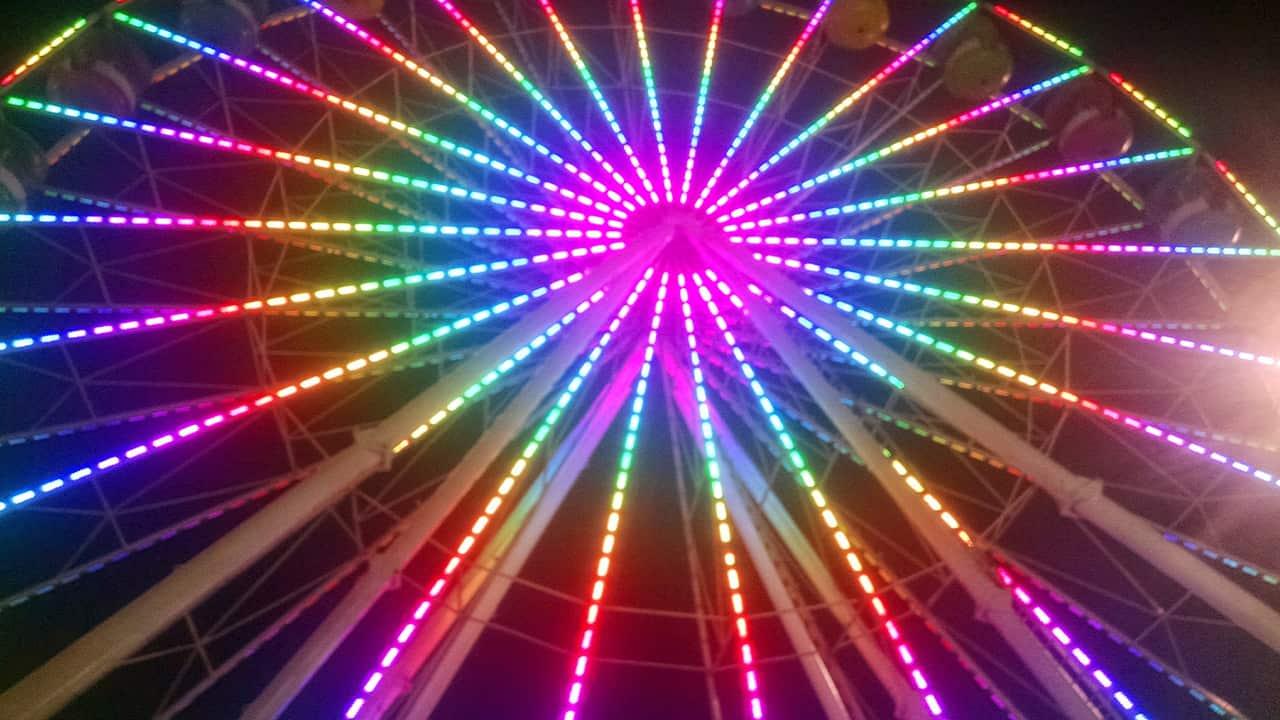 Photo of a ferris wheel at night