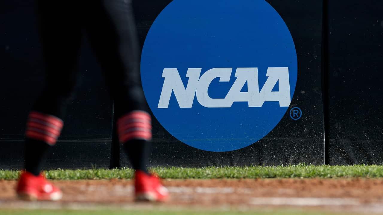 Photo of an athlete near the NCAA logo