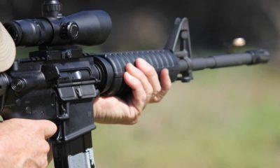 Photo of a man firing a machine gun