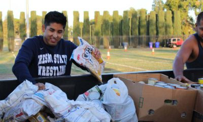 """Photo of Fresno State students help out during the 2018 """"Feed the Need"""" food drive for the Student Cupboard"""