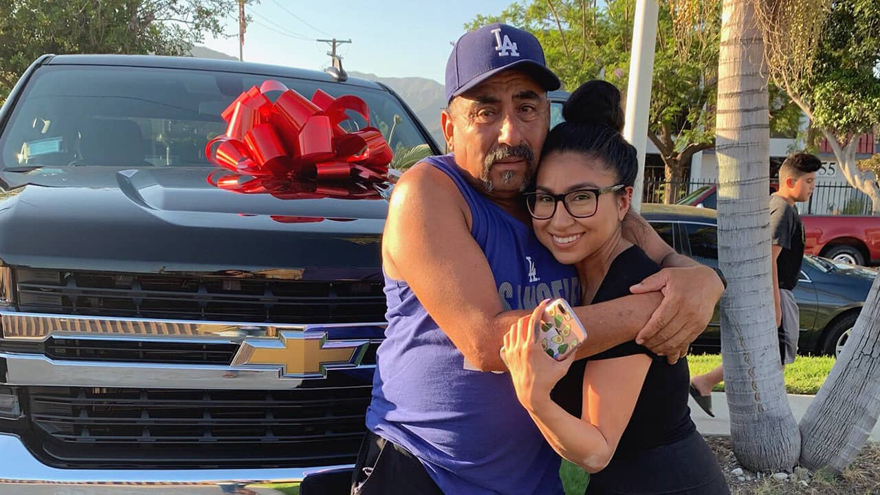 Photo of Yesenia Valencia and her dad after she surprised him with a new truck