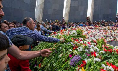 Photo of Armenians placing flowers at Armenian genocide memorial in Yerevan, Armenia