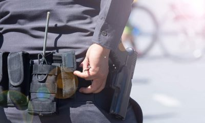 Photo of a police belt and gun