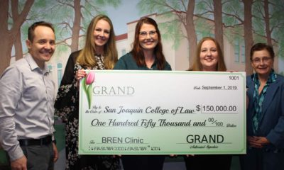Photo of check presentation of $150,000 from GRAND to the SJCL for the BREN Clinic