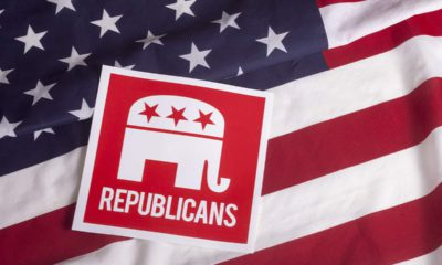 Photo of a Republican sign on an American flag