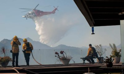 Photo of helicopter dropping water