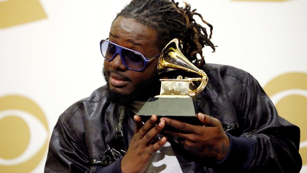 Photo of T-Pain holding his Grammy award