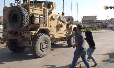 Photo of residents throwing potatoes at military vehicles