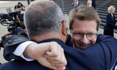 Photo of Attorney Mark Lanier getting a hug