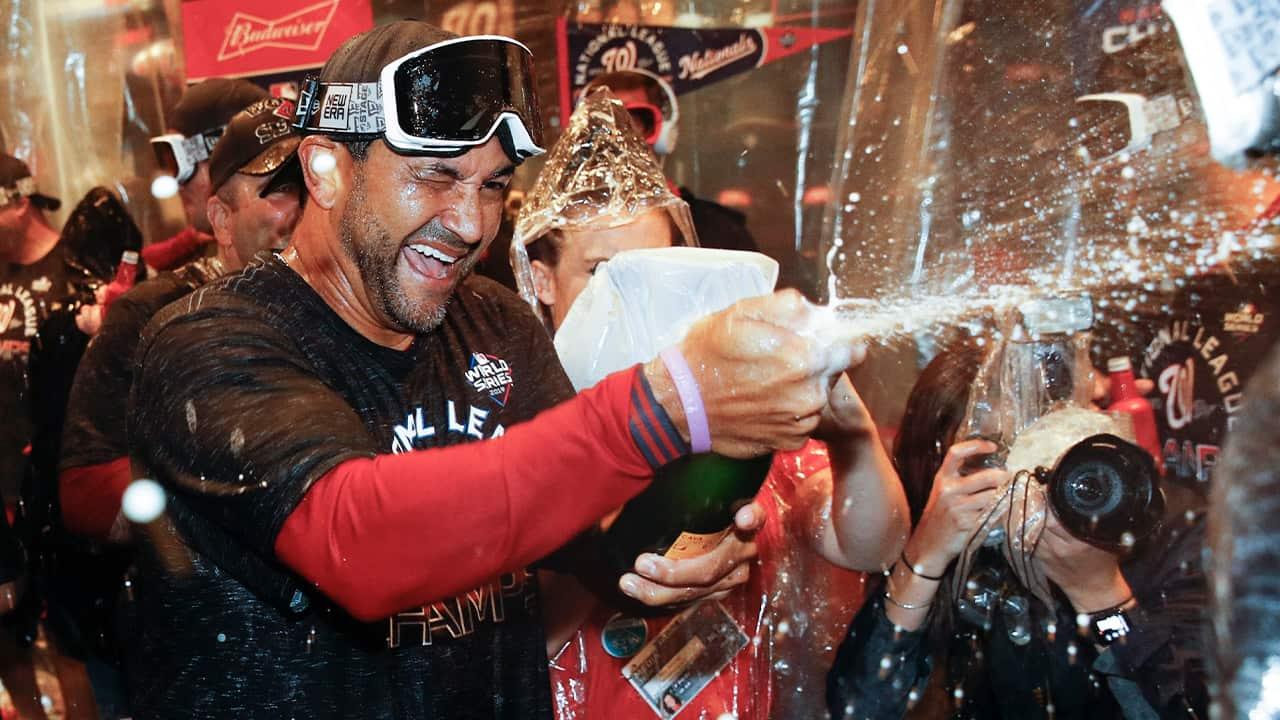 Photo of Washington Nationals manager Dave Martinez celebrating