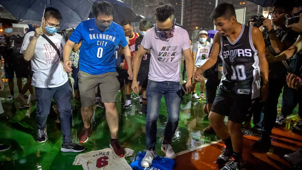 Photo of Hong Kong protestors stomping on LeBron James jerseys