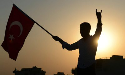 Photo of someone holding a Turkish flag