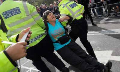 Photo of police arresting a climate demonstrator