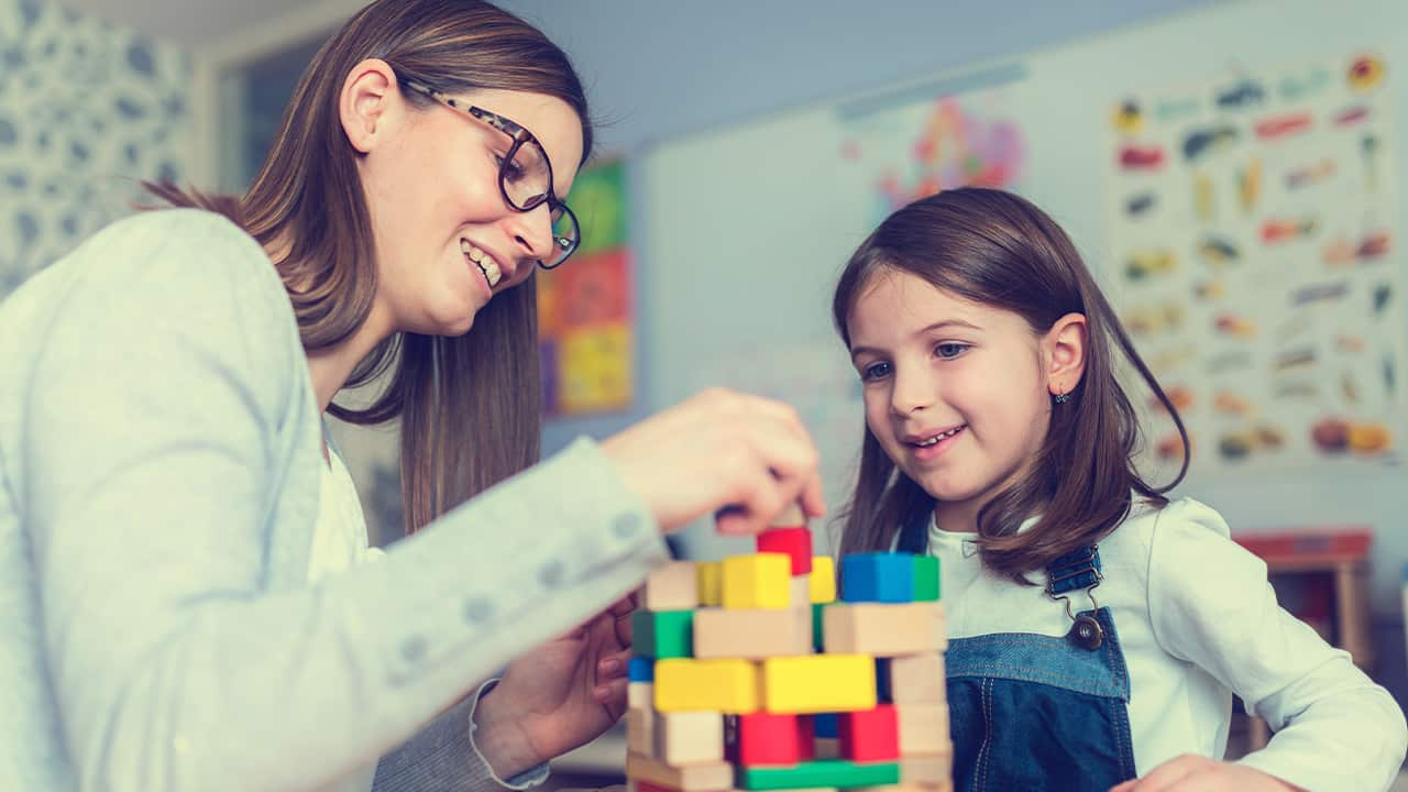 Photo of woman and child with building blocks