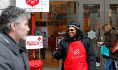Photo of bell ringer Carolyn Harper encouraging people to donate