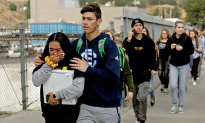 Photo of students being escorted out of Saugus High School