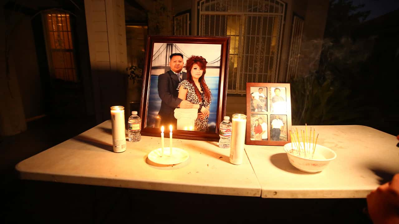 """In this photo taken Monday, Nov. 18, 2019, a memorial for shooting victim Kou Xiong sits in front of his home where he was shot in Fresno, Calif. A close-knit Hmong community was in shock after gunmen burst into a California backyard gathering and shot 10 men, killing four. """"We are right now just trying to figure out what to do, what are the next steps. How do we heal, how do we know what's going on,"""" said Bobby Bliatout, a community leader. (Larry Valenzuela/The Fresno Bee via AP)"""