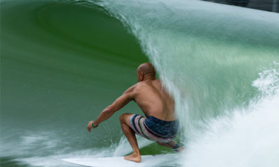 Photo of a man surfing at a wave park in Lemoore, California