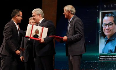 Photo of UCLA professor Ali Khademhosseini receiving an award