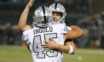 Photo of Derek Carr hugging Alec Ingold