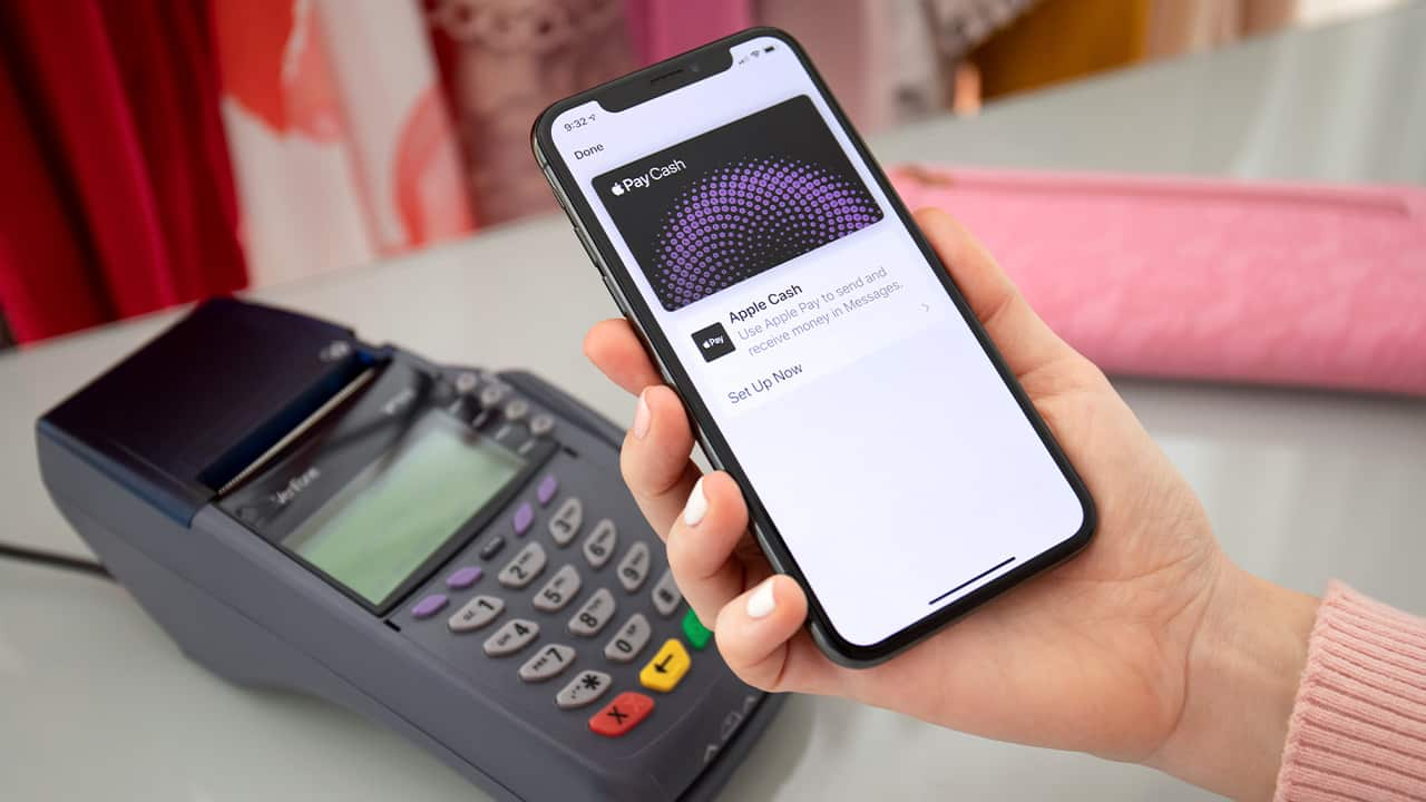 Photo of a woman paying with Apple Pay