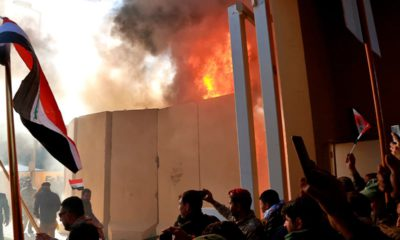 Photo of protestors attacking the U.S. Embassy in Iraq