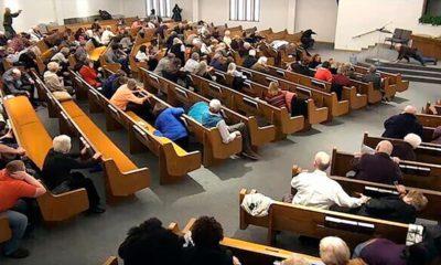 Photo of churchgoers taking cover