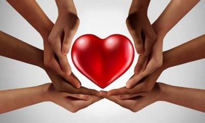 Picture of hands surrounding a heart symbolizing philanthropy