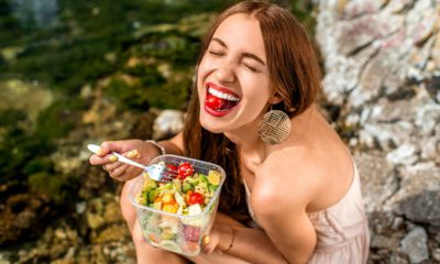 Photo of a woman eating a salad
