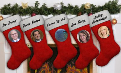 composite image of Christmas stockings and portraits of politicians