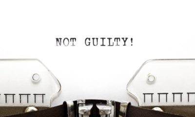 """the words """"Not Guilty!"""" on white paper in a typewriter"""