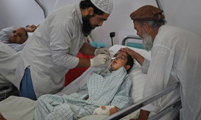 Photo of a paramedic tending to Nesser Ahmad