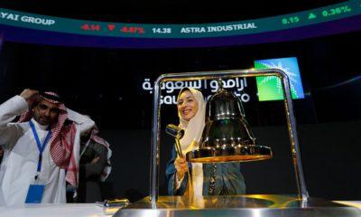 Photo of Sukaynah Al Oqaili ringing the stock bell