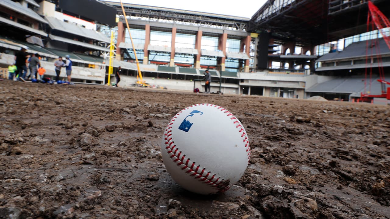 Photo of a baseball on packed dirt