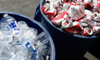 Photo of water bottles and Budweiser cans