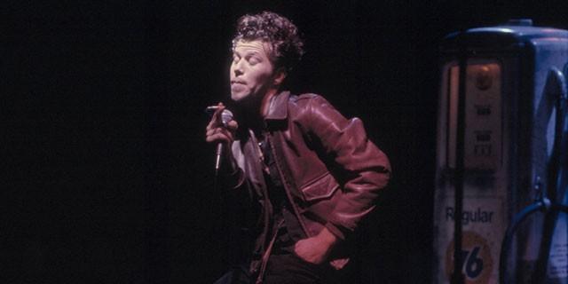 Photo of Tom Waits singing