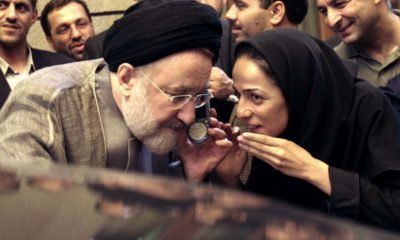 Photo of outgoing reformist Iranian President Mohammad Khatami talking on the phone
