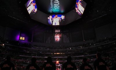 Photo of The Los Angeles Clippers standing for a tribute to Kobe Bryant