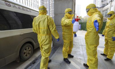 Photo of funeral workers disinfecting themselves