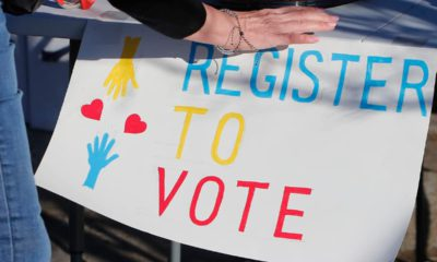 Photo of a Register to Vote sign